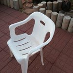 dirty plastic Walmart patio chair.