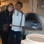 Thanasis hotel owner/Gourmet cooking roast of lamb in woodfired oven
