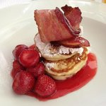 Pancakes with strawberries(cooked) and that awesome bacon again.