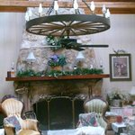 wagon wheel chandelier & stone fireplace