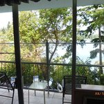 nice chairs on the deck - thru the trees is the bay
