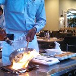 Omar preparing Bananas Foster French Toast table-side