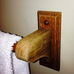 Worn wooden towel rack
