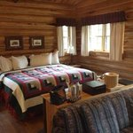 bed area of wild lily cabin.  charming, comfortable and private. we loved it!