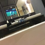 bathroom with TV inside the mirro