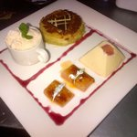 Duo of rhubarb deserts, sharing plate of rhubarb crumble, and rhubarb pannacotta