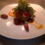 Pork fillet with potato cake, braised shallots and sweet potato puree