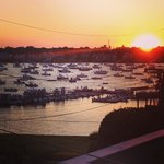 View from Lady Winette: The sun setting over Marblehead Harbor