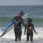 G. G.'s surf lesson with Tommy.