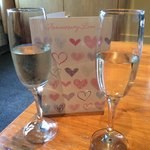 Prosecco and anniversary card in room on arrival