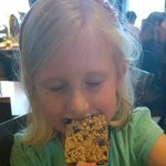 My daughter enjoying a kids' dessert - rice krispie treat popsicle with chocolate chips