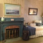 Grand Central Room fireplace and twin bed