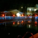 View from bar of pool at night.