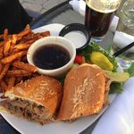 French Dip with loads of thinly sliced Roast Beef and sweet potato fries