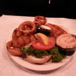 Blackened mahi mahi sandwich w/onion rings.