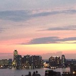 View uf Hudson river from rooftop terrace at dusk