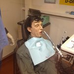 Mannequin in ship's dental office - grimace and fake blood!
