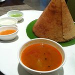 Freshly prepared dosa with chutneys