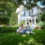 Adirondacks on front lawn to relax and enjoy a cocktail