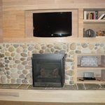 Flat screen above fireplace.