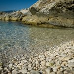 This is what every beach is like in Rabac, crystal clear waters with pebble beaches.