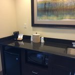 Kitchenette as you enter room.  Sink, bar fridge, microwave and cabinets.