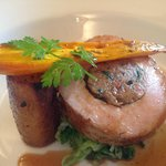 Stuffed Sous Vide Pork Loin with Pork Belly, Grilled Shallots and Roasted Carrot
