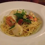 Linguini with shrimp and scallop tossed in white wine sauce with an abundance of organic herbs -