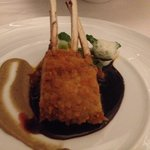 Bread crusted of Austrailian milk fed - lamb rack with eggplant caviar, vegetable dumplings and