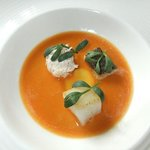lobster bisque with crab, stone bass and pollock and a sea fennel garnish.