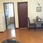 Kitchen, Toilet Door & Dining for two of 1BHK Serviced apt.