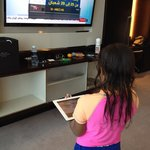 My daughter operating the TV using the ipad.