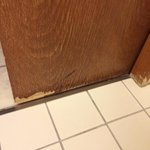 Bathroom's door has already worn out from leaking water through the time. Management careless.