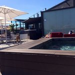 The rooftop pool and bar area