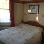 Here is double bed, in the triple room. There is also a single bed, which can't be seen in this