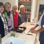 Some of our ladies chat to Rich Rorich The Chef whilst he prepares our dinner