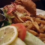 Lobster croissant with fries.