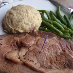 Prime rib, red smashed potatoes, green beans.