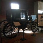 A collection of antique vehicles housed in stables