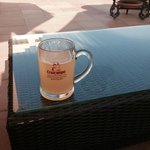 lemon cruzcampo beer by the pool