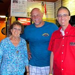 Owner Al Grabo (c) promotes a great experience along with great food at affordable prices.