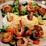 Seafood risotto with grilled shrimp and veggies.