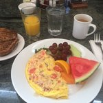 Omelette with fruit and toast. Awesome.