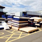 All the mattresses piled up outside reception