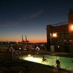 Rooftop pool/garden/hot tub area at night; looking toward Elliott Bay.