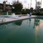Green pool, 3 open gates, no signs saying pool is closed...