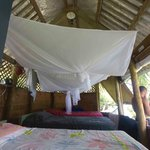 Our beachfront fale - usually 2 beds but we squeezed 3