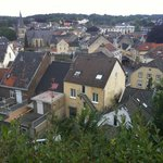 View of Valkenhof from castle ruins; hotel is center yellow bldg with skylights.