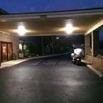 Motorcycle under the entrance canopy.