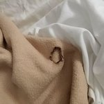 Burned hole in the blanket.